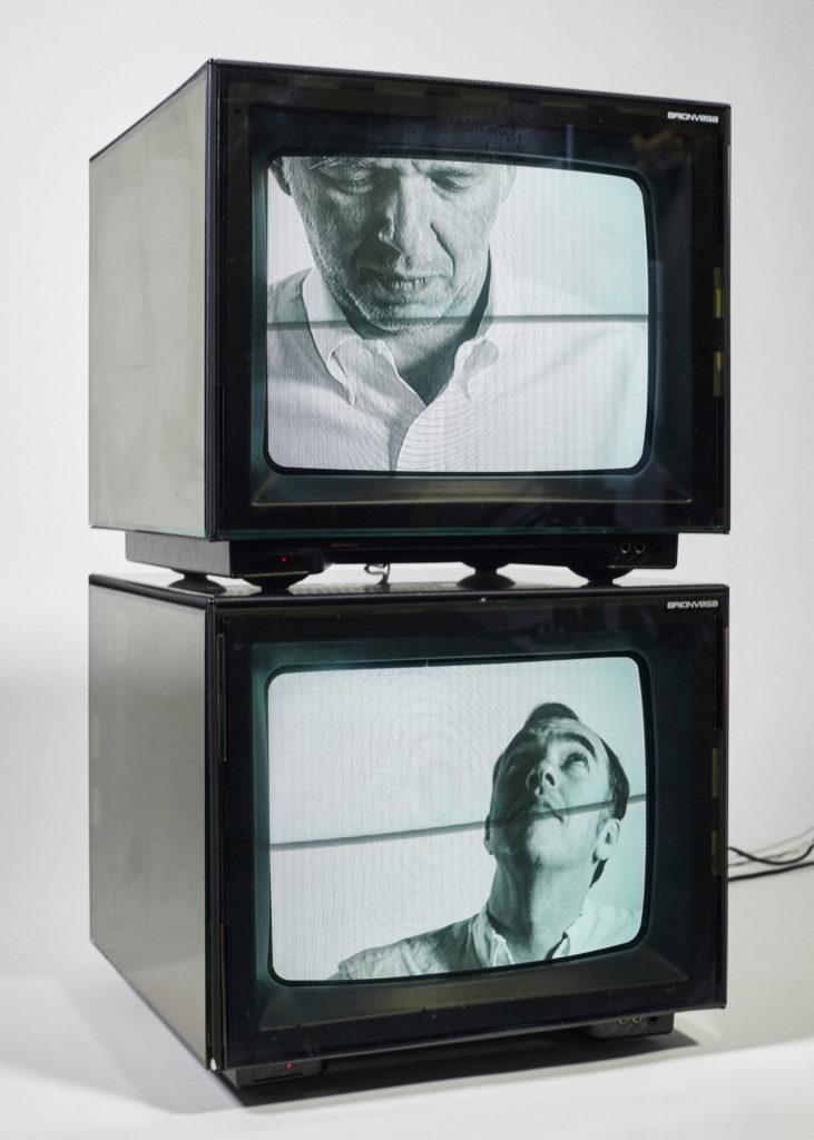 Zwei Monitore mit Foto-Ausschnitten von zwei Mitgliedern von Soulwax